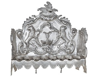Hanukka menorah - Inv. No. JMP 066.185 Prague, 1767, maker: KV Hammered and chased silver On permanent display in the Klausen Synagogue (ground floor)
